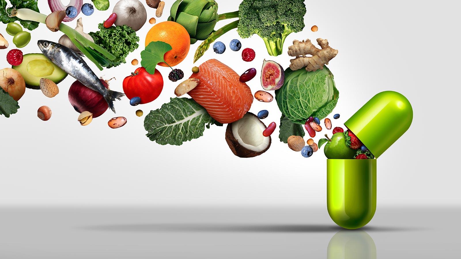 Illustration: Gesundes Obst und Gemüse fliegen in eine Kapsel Nahrungsergänzungsmittel